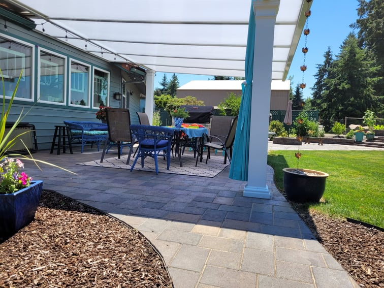Paved patio with semi-opaque shade roof
