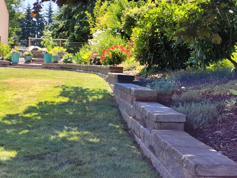 Terraced brick border for raised sloped beds